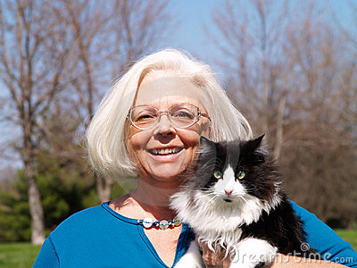 Senior woman holding a cat
