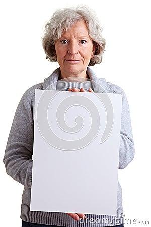 Senior woman holding empty