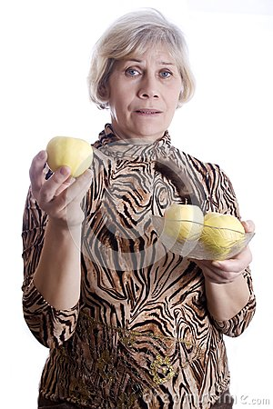 Senior woman holding fruits