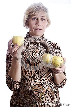 Senior woman holding fruits