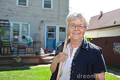 Senior woman holding gardening tool