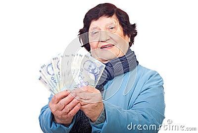 Senior woman holding Romanian money