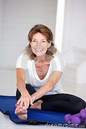 Senior woman at home exercising