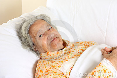 Senior woman in the hospital bed