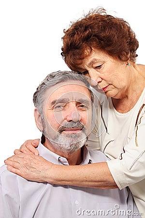 Senior woman hugs seat man