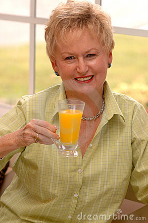 Senior woman with juice