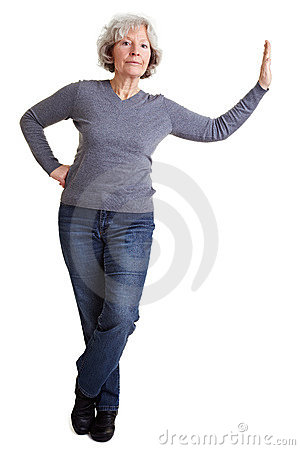 Senior woman leaning on imaginary