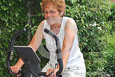 Senior woman listening to music during workout