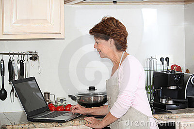 Senior woman looking for recipe