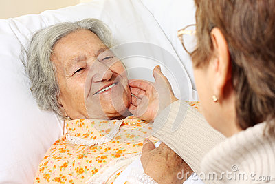 Senior woman lying in bed