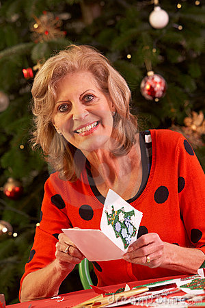 Senior Woman Making Christmas Cards At Home