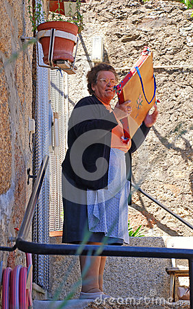 Senior woman in medieval village Idanha-a-Velha, Portugal. Editorial Stock Image