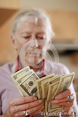 Senior woman money
