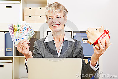 Senior woman in office with money