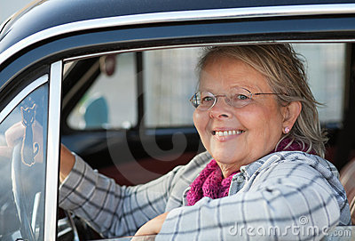 Senior woman in oldtimer car