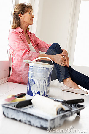 Senior woman painting house