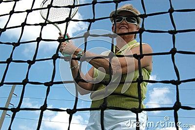 Senior woman playing tennis