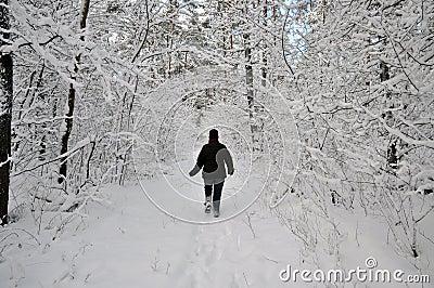 Senior woman plowing through the snow