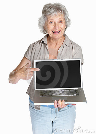 Senior woman pointing to a laptop screen