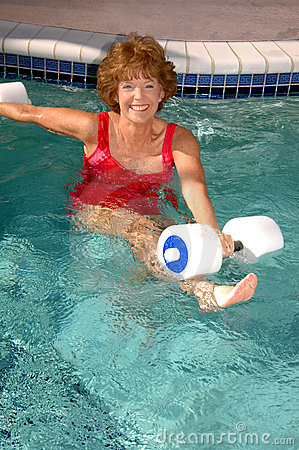 Senior woman pool exercises