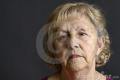 Senior woman portrait on black