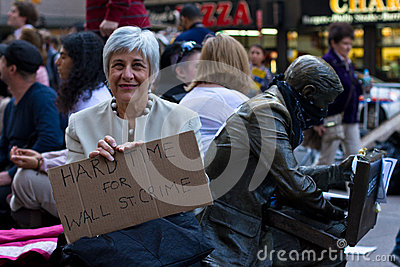 Senior woman with protest sign at Occupy Wall Street Editorial Image