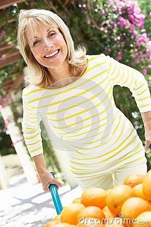 Senior Woman Pushing Wheelbarrow