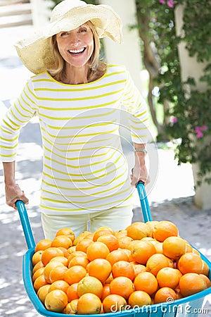 Senior Woman Pushing Wheelbarrow F