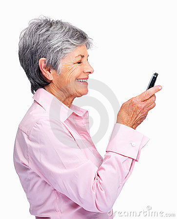 Senior woman reading text message on cellphone