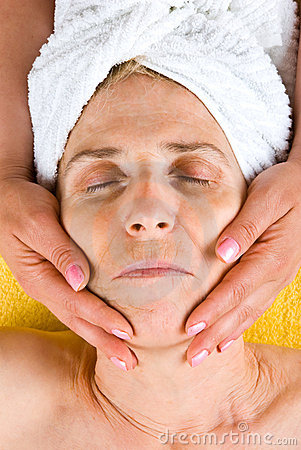 Senior woman receiving a facial massage