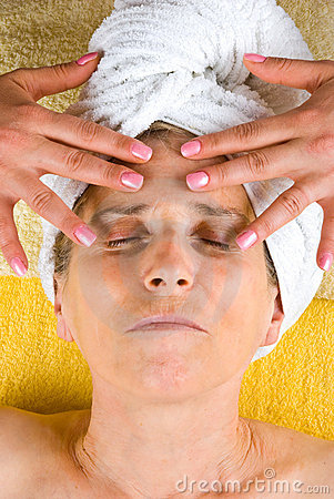 Senior woman receiving facial massage