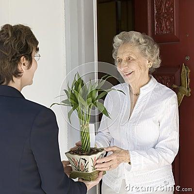 Senior woman receiving gift
