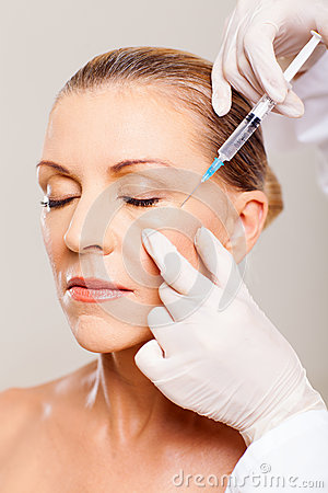 Senior woman cosmetic injection