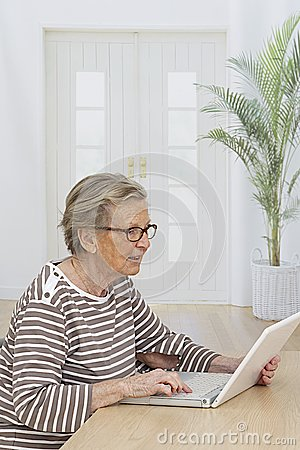 Senior woman relaxing with her laptop