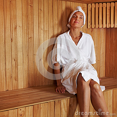 Senior woman relaxing in sauna