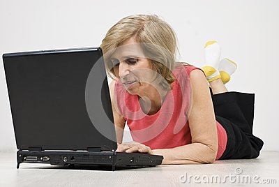 Senior woman relaxing and using laptop