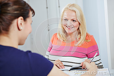Senior woman scheduling appointment