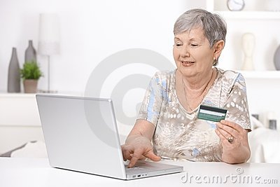 Senior woman shopping on internet
