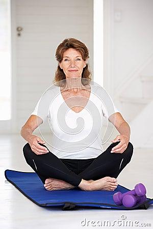 Senior woman sitting in lotus position