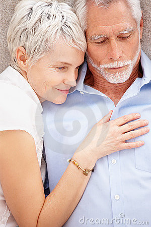 Senior woman sleeping comfortably by her husband