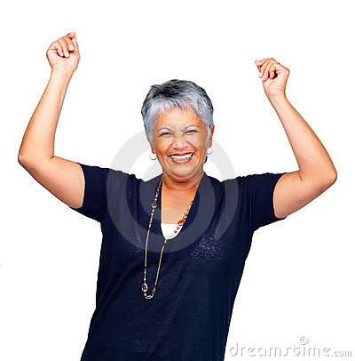 Senior woman smiling over white with hands raised