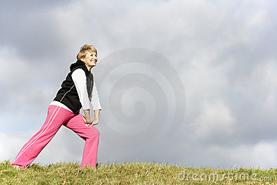 Senior Woman Stretching In Park