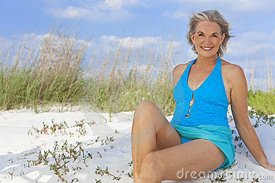 Senior Woman In Swimming Costume At Beach