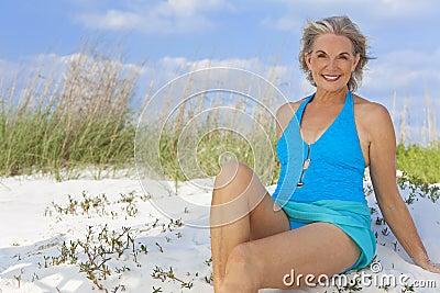 Senior Woman In Swimming Costume At Beach