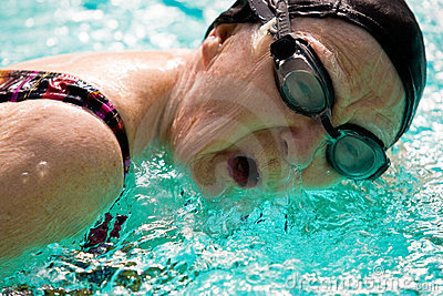 Senior Woman Swimming in a pool
