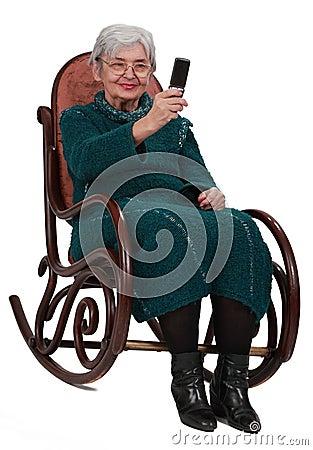 Senior woman taking photos with a phone