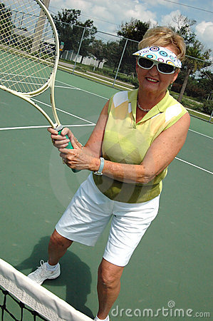 Senior woman on tennis court