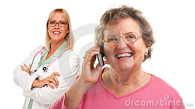 Senior Woman Using Cell Phone with Female Doctor