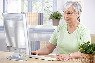 Senior woman using computer at home