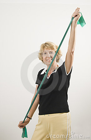 Senior woman using exercise band